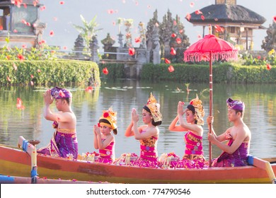 Beratan Lake, Bali, Indonesia, Dec 7 2017 : Balinese villagers participating in traditional religious Hindu procession in Ulun Danu temple Beratan Lake in Bali, Indonesia