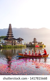 Beratan Lake in Bali Indonesia, June 6 2018 : Balinese villagers participating in traditional religious Hindu procession in Ulun Danu temple Beratan Lake in Bali Indonesia, vintage color tone.