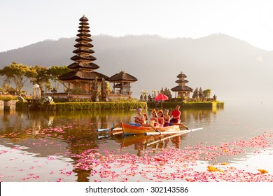 Beratan Lake in Bali Indonesia, June 16 2015 : Balinese villagers participating in traditional religious Hindu procession in Ulun Danu temple Beratan Lake in Bali Indonesia, June 16 2015