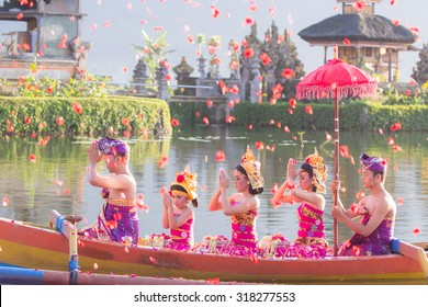 Beratan Lake, Bali, Indonesia, June 16 2015 : Balinese villagers participating in traditional religious Hindu procession in Ulun Danu temple Beratan Lake in Bali, Indonesia, June 16 2015