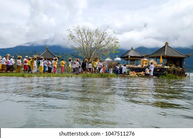 Beratan Lake, Bali, Indonesia - March 13th 2018 : Hindu people are conducting melasti ceremony at the edge of the beratan lake in order to welcome the Nyepi holiday