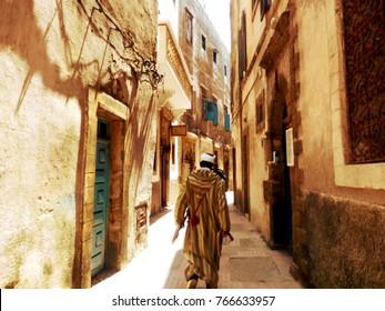 Berber Man walking down narrow street in Essaouria, Morocco.