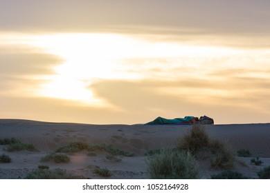 Berber sleeping on the dune in Sahara desert, Morocco.