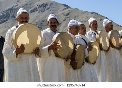 Berber village, Morocco - October 7, 2018:  Old berbers play folk music in traditional white clothes.