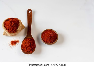 Berbere is the main part in the cuisines of Ethiopia and Eritrea. A mixture of spices, usually including red pepper, ginger, cloves, coriander, allspice. White marble background.