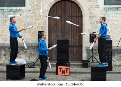 Berchem-Sainte-Agathe, Brussels / Belgium - 07 15 2017: The jugglers of Compagnie Scratch  during the visual summer street festival