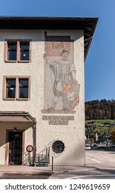 Berchtesgaden, Bavaria / Germany - October 2018: Mosaic from Nazi-era time with removed swastika on the flag. Berchtesgaden is an alpine town in Bavaria that once was a home for Adolf Hitler.