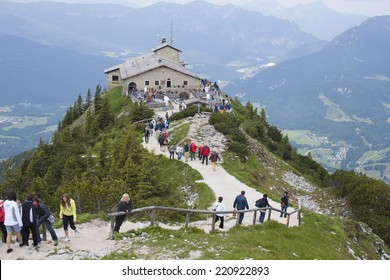 """BERCHTESGADEN,GERMA NY, JUNE 14, 2013: Tourists visit Kehlsteinhaus in Obersalzberg. The """"Eagle's Nest"""" was built for Adolph Hitler for his 50th birthday. Located at an altitude of 1834 m asl"""