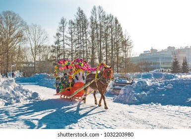 Berdsk, Novosibirsk oblast, Siberia, Russia - February 18, 2018: the Holiday of Maslenitsa. Riding in a sleigh pulled by horses