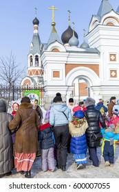 Berdsk, Novosibirsk oblast, Siberia, Russia - February 26, 2017: Russian holiday of Maslenitsa, national street festivities at the Church