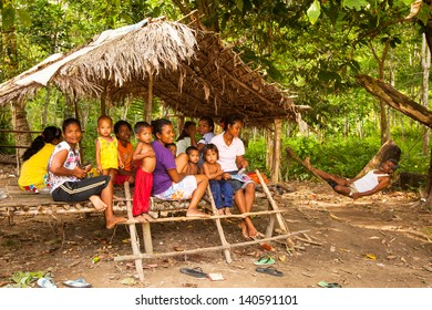 BERDUT, MALAYSIA - APR 8: Unidentified children Orang Asli in his village on Apr 8, 2013 in Berdut, Malaysia. More than 76% of all Orang Asli live below the poverty line, life expectancy 53 years old.