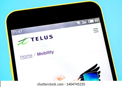 Berdyansk, Ukraine - 14 May 2019: Illustrative Editorial of TELUS website homepage. TELUS logo visible on the phone screen.