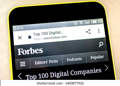 Berdyansk, Ukraine - 15 May 2019: Forbes Top 100 website homepage. Forbes logo visible on the phone screen.
