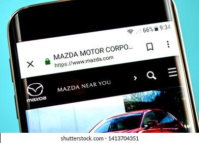 Berdyansk, Ukraine - 30 May 2019: Mazda Motor website homepage. Mazda Motor logo visible on the phone screen.