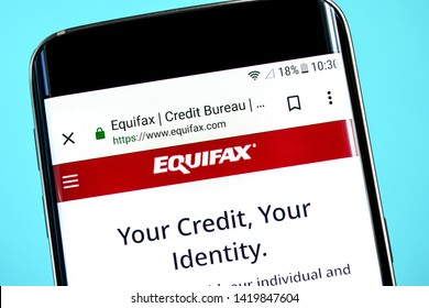 Berdyansk, Ukraine - 8 June 2019: Equifax website homepage. Equifax logo visible on the phone screen, Illustrative Editorial.