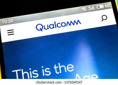 Berdyansk, Ukraine - April 18, 2019: Illustrative Editorial of Qualcomm website homepage. Qualcomm logo visible on the phone screen.