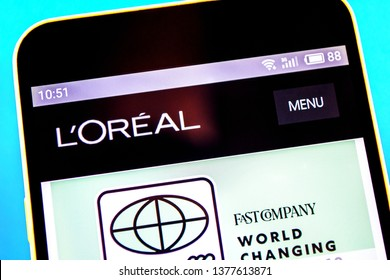 Berdyansk, Ukraine - April 21, 2019: Illustrative Editorial, LOreal Group website homepage. LOreal Group logo visible on the phone screen.