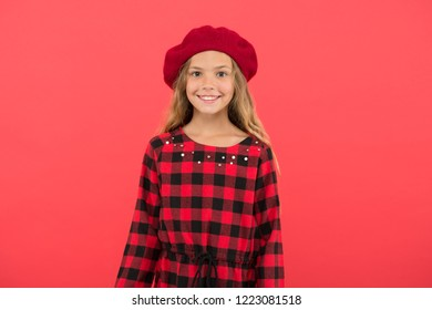 Beret style inspiration. How to wear beret like fashion girl. Fashionable beret accessory for female. Kid little cute girl with long hair posing in hat red background. How to wear french beret.