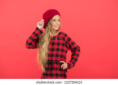 Beret style inspiration. How to wear beret like fashion girl. Kid little cute girl with long hair posing in hat red background. Fashionable beret accessory for female. How to wear french beret.