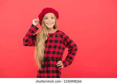 Beret style inspiration. How wear beret like fashion girl. Kid little girl with long hair posing in hat and checkered dress on red background. Fashionable beret hat for female. French style beret hat.