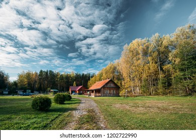 Berezinsky, Biosphere Reserve, Belarus. Traditional Belarusian Tourist Guest Houses In Autumn Landscape. Popular Place For Rest And Active Eco-tourism In Belarus.