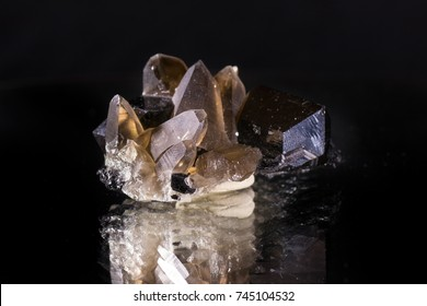Berg Crystal and lodestone on black