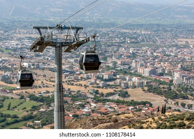 BERGAMA, TURKEY - JULY 10, 2013 : Cable cars ferry tourists from the modern town of Bergama up to the ancient site of Pergamum (Pergamon).