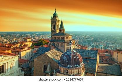Bergamo city - Scenic sunse view of the Old city and Basilica of Santa Maria Maggiore and Cappella Colleoni in Citta Alta, Italy