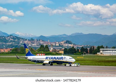 Bergamo, Italy -30 April 2019: Ryanair Plane ready for takeoff in the airport of Bergamo. Orio al Serio airport near Milan-Italy. We see in the background the old town of Bergamo, called upper town
