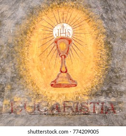 "Bergamo, ITALY - April 21, 2016: Fresco depicting the sacred chalice of Jesus. ""Eucaristia"" in Italian means: Eucharist, Holy Communion, Communion."