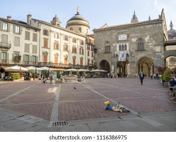 BERGAMO, ITALY - APRIL 27th 2018: People walking on the main square of the Bergamo old city on a spring afternoon.