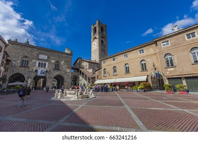 BERGAMO, ITALY - APRIL 28, 2017: Unidentified people at Piazza Vecchia in Bergamo. Piazza Vecchia is old square in center of medieval Citta alta (upper city) in Bergamo.