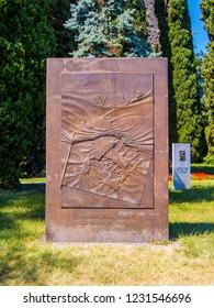 """BERGAMO, ITALY - AUGUST 27, 2018: Monument """"To the Fallen of Legnano, during the Liberation War (1943-1945)"""". Rocca Complex, Remembrance Park (Italian: Rocca di Bergamo, Parco delle Rimembranze)."""