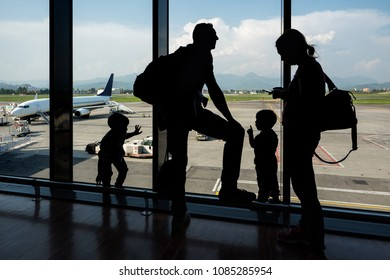 BERGAMO, ITALY - CIRCA APRIL, 2018: Silhouette of unidentified family waiting at the airport.