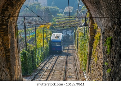 BERGAMO, ITALY - DECEMBER 12, 2016: View from tunnel at morning light with funicular Railway in Citta Alta Bergamo.