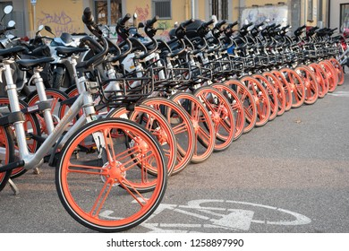 Bergamo, Italy. December 6, 2018. Bike-sharing bicycles parked in a public area near the train and bus station. Mobike.