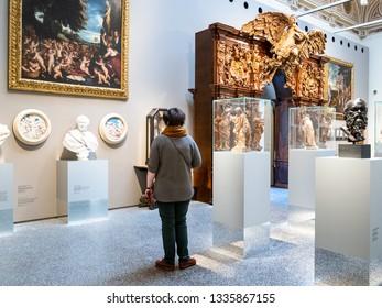 BERGAMO, ITALY - FEBRUARY 20, 2019: visitor in hall of Accademia Carrara di Belle Arti di Bergamo (Art Gallery and Academy of Fine Arts) in Bergamo city, Lombardy