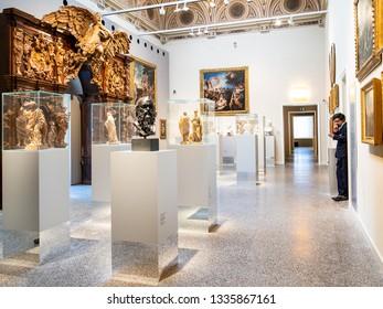 BERGAMO, ITALY - FEBRUARY 20, 2019: attendant in hall of Accademia Carrara di Belle Arti di Bergamo (Art Gallery and Academy of Fine Arts) in Bergamo city, Lombardy