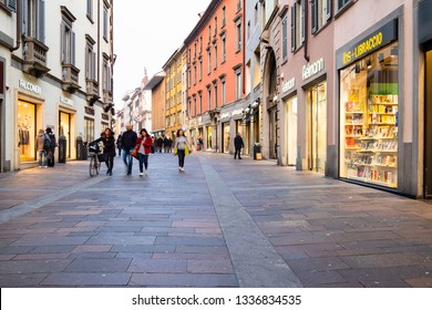 BERGAMO, ITALY - FEBRUARY 20, 2019: people walk on street Via XX Settembre in Bergamo city along shops in evening. Bergamo is the capital of the Province of Bergamo in the Lombardy region of Italy