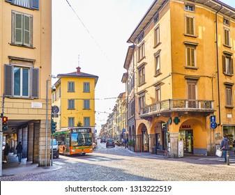 Bergamo, Italy - January 4, 2019. A Urban Bus crossing Via Giovanni Battista Moroni at Citta Bassa, Bergamo, Lombardy, Italy. View from Via Zambonate street.
