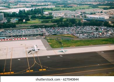 Bergamo, Italy - July 01, 2015: Aerial View Of Runway Of Orio Al Serio International Airport. Il Caravaggio International Airport, Is An International Airport Located In 3.7 Km Southeast Of Bergamo