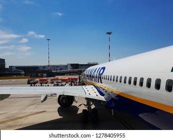 Bergamo, Italy - July 17 2018: Milan Bergamo airport tarmac passengers boarding. Travelers at apron area of Orio al Serio Caravaggio International airport, board front entrance of a Ryanair aircraft.