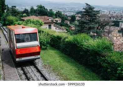 BERGAMO, ITALY - JUNE 16, 2016: Funiculare San Vigilio - red funicular in old city of Bergamo.