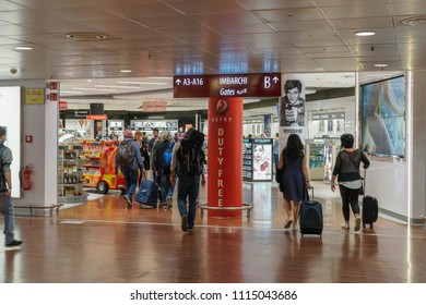 Bergamo, Italy - May 13 2018: Orio Al Serio airport. Crowd at duty free shops with gate sign inside Aeroporto internationale di Orio al Serio, hub for low cost airlines flights to Milan.