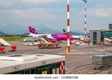 Bergamo, Italy - May 2, 2018: Wizzair and Ryanair airplanes boarding at the airport in Bergamo Orio Airport. It is one of fastest growing airports in Italy.