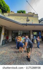 BERGAMO, ITALY - MAY 29, 2018: Entrance of Funicular San Vigilio with tourists, Funiculare S. Vigilio, upper city, Bergamo, Italy