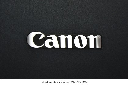BERGAMO, ITALY - OCTOBER 12, 2017: Canon logo on printer. Canon is a corporation specialized in manufacturing of imaging and optical products.