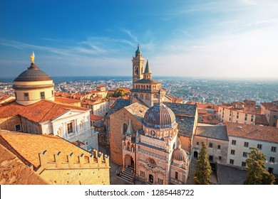 Bergamo, Italy.  Scenic view of the old town city center and Basilica of Santa Maria Maggiore and Cappella Colleoni in Citta Alta. Landscape of the historical buildings during the sunset.