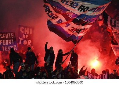 BERGAMO, ITALY-JANUARY 30, 2019: Atalanta's soccer fans cheering with red smoke bombs and waving flags, during the Italian Cup match Atalanta vs FC Juventus, in bergamo.