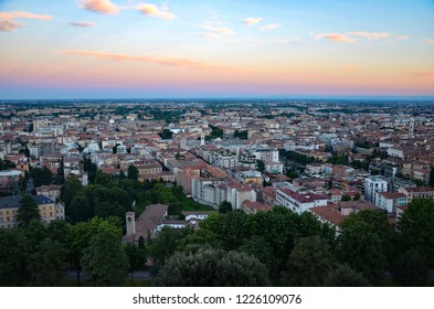 Bergamo in Lombardy in Italy at sunset, view from the cable railway station towards the lower town